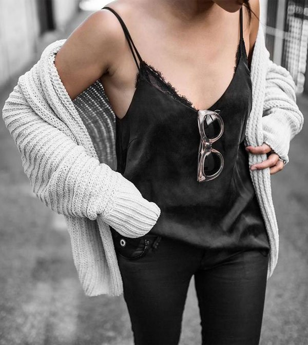 black pants black top grey sweater