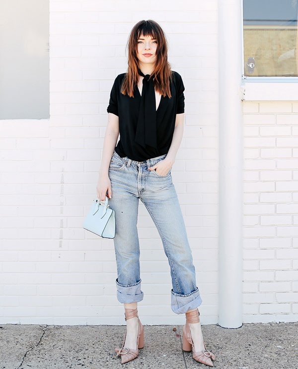 denim pants black blouse street style