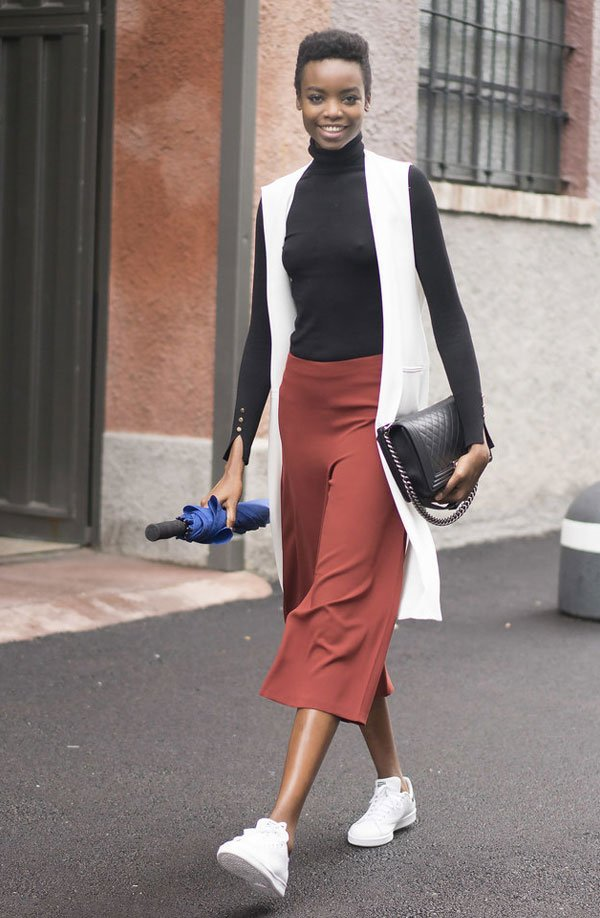 look black turtleneck red culotte