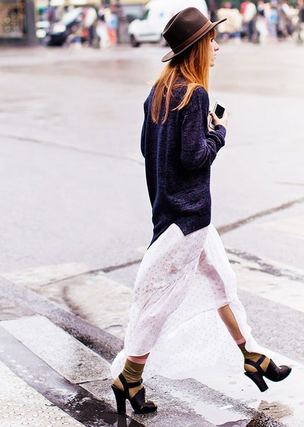 look skirt hat over sweater street style