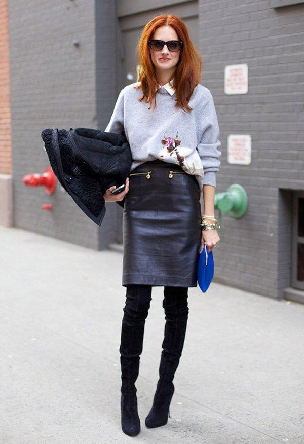 Street style look com camisa branca, moletom, siaa couro preta lápis e bota over the knee.