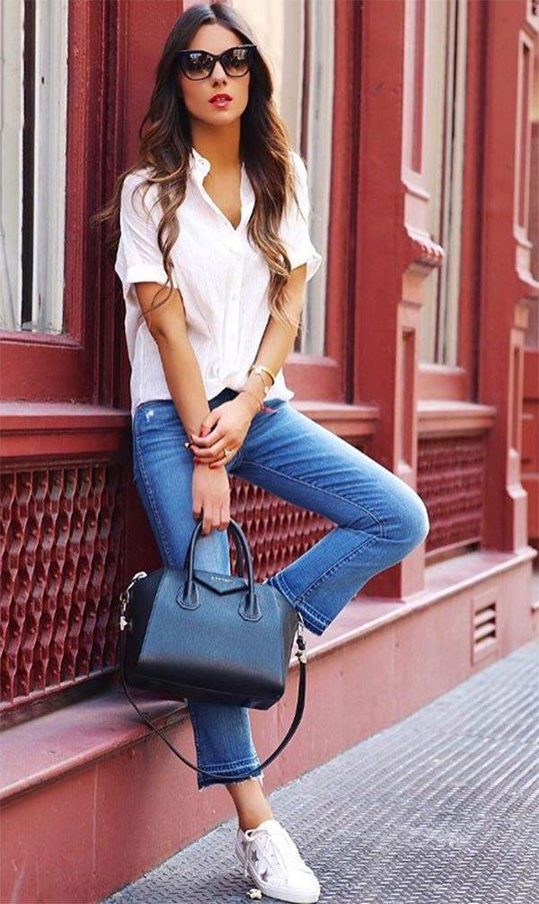 Street style look com calça jeans e camisa branca.