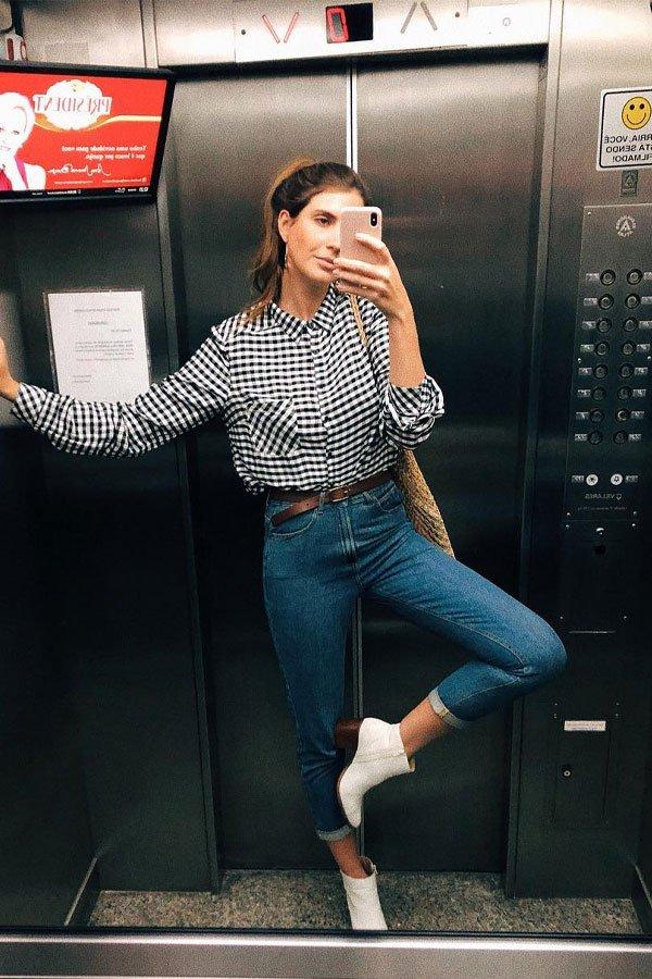 Manuela Bordasch - calça e camisa e bota - calça jeans - meia-estação - street style