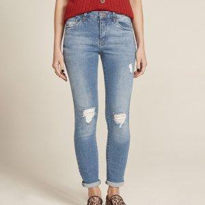 Calça Jeans Feminina Cigarrete Com Rasgos Azul Médio